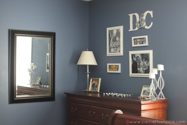 A big mirror in a room with a dark paint color will help bounce light through the room.  Great tip!