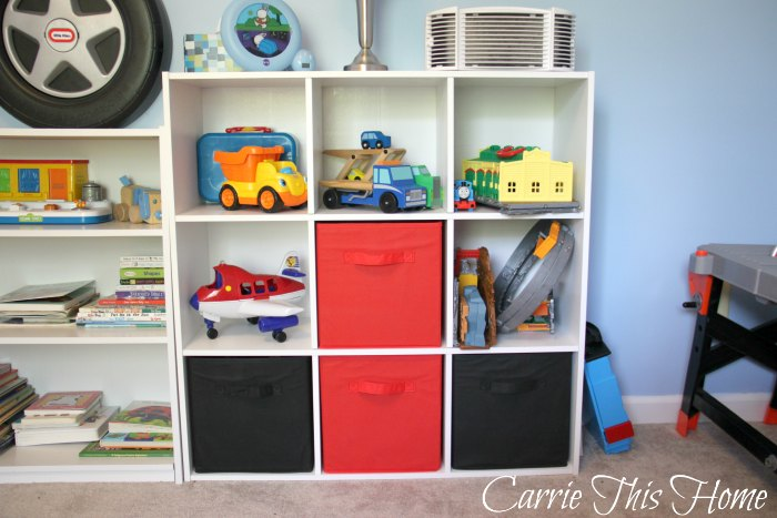 Tackle kids clutter by choosing furniture that gives all those toys a home. This storage unit is a great way to store a lot of items without taking up too much floor space.