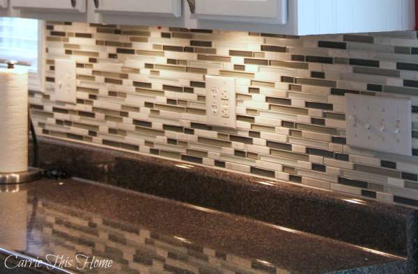 Such a pretty glass and marble backsplash!