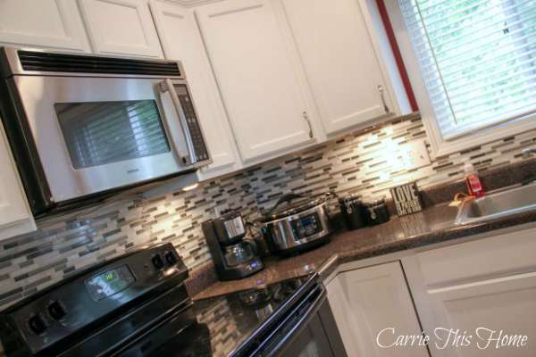 Under cabinet lighting adds a good mood to the kitchen! Budget Kitchen Makeover