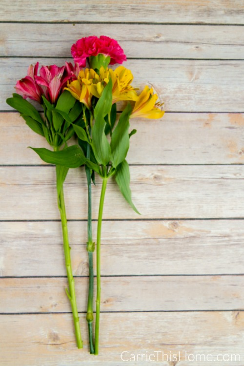 Cut the stems to fit the vase and remove any excess leaves