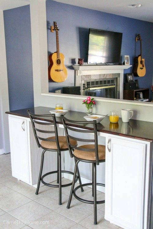 Build this multifuctional DIY Breakfast bar & make more use out of an awkward space! Turorial from CarrieThisHome.com