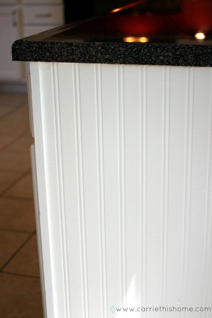 Use wainscoting wallpaper on cabinet ends for an upgraded look on the cheap!