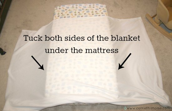 How to keep a toddler warm at night-tuck in a big fleece blanket under their mattress on both sides