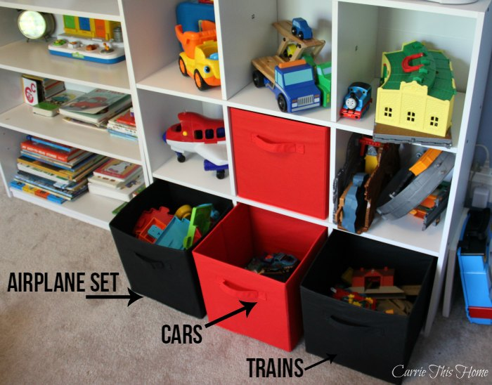 Tackle kids clutter by categorizing toys into bins. This makes it easy for the kids to clean up!