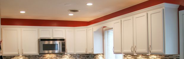 Add crown moulding for an easy way to update the look of your kitchen cabinets! Cabinets after crown moulding. This is much better!