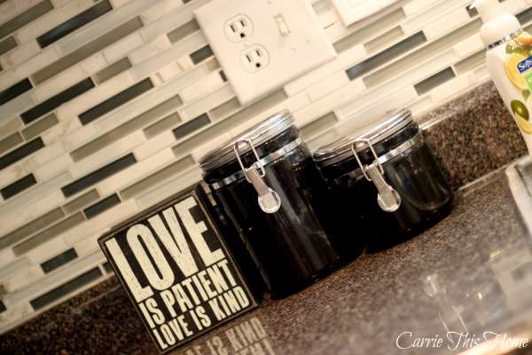Love this glass and marble backsplash!