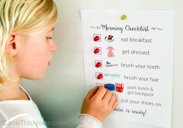 Get this free printable morning checklist-it's a lifesaver for my morning routine! The secret to getting kids ready without nagging from CarrieThisHome.com